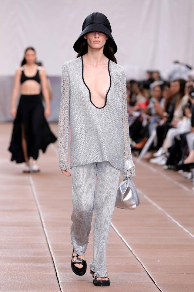 <p>A model walks the 3.1 Phillip Lim Spring 2019 runway wearing a classic black bucket hat and a shimmery silver two-piece set. (Photo: Getty Images) </p>