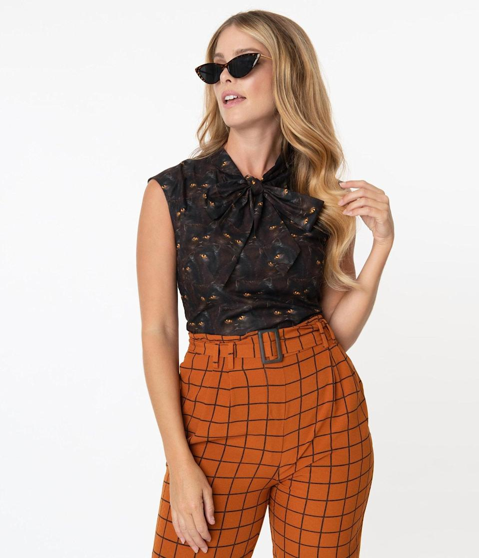 <p>There's no need to be a scaredy cat when it comes to this cute <span>Retrolicious Black Cat Print Blouse</span> ($48).</p>
