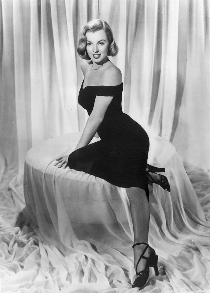 """The actress wears a black cocktail dress in a promo image for the 1950 movie """"The Asphalt Jungle."""""""