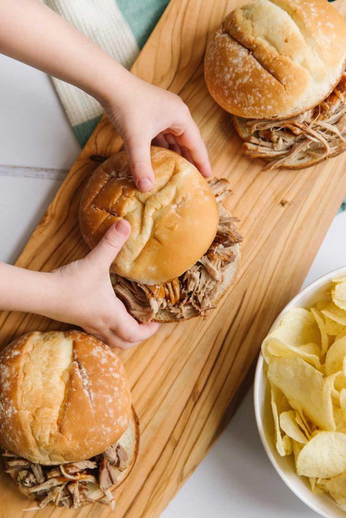 """<p>Southerners love their barbecue, and this pulled pork slider recipe is the perfect meal to enjoy at a backyard barbecue. It's also one of those <a href=""""https://www.thedailymeal.com/make-ahead-meals-you-can-freeze?referrer=yahoo&category=beauty_food&include_utm=1&utm_medium=referral&utm_source=yahoo&utm_campaign=feed"""" rel=""""nofollow noopener"""" target=""""_blank"""" data-ylk=""""slk:comfort foods you can make and then freeze."""" class=""""link rapid-noclick-resp"""">comfort foods you can make and then freeze.</a></p> <p><a href=""""https://www.thedailymeal.com/recipes/pulled-pork-sliders-recipe-1?referrer=yahoo&category=beauty_food&include_utm=1&utm_medium=referral&utm_source=yahoo&utm_campaign=feed"""" rel=""""nofollow noopener"""" target=""""_blank"""" data-ylk=""""slk:For the Pulled Pork Sliders recipe, click here."""" class=""""link rapid-noclick-resp"""">For the Pulled Pork Sliders recipe, click here.</a></p>"""