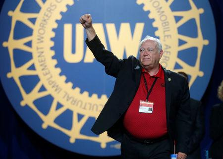 United Auto Workers union president Dennis Williams raises his arm in solidarity after his farewell speech during the 37th Constitutional Convention in Detroit, Michigan, U.S. June 13, 2018.  REUTERS/Rebecca Cook