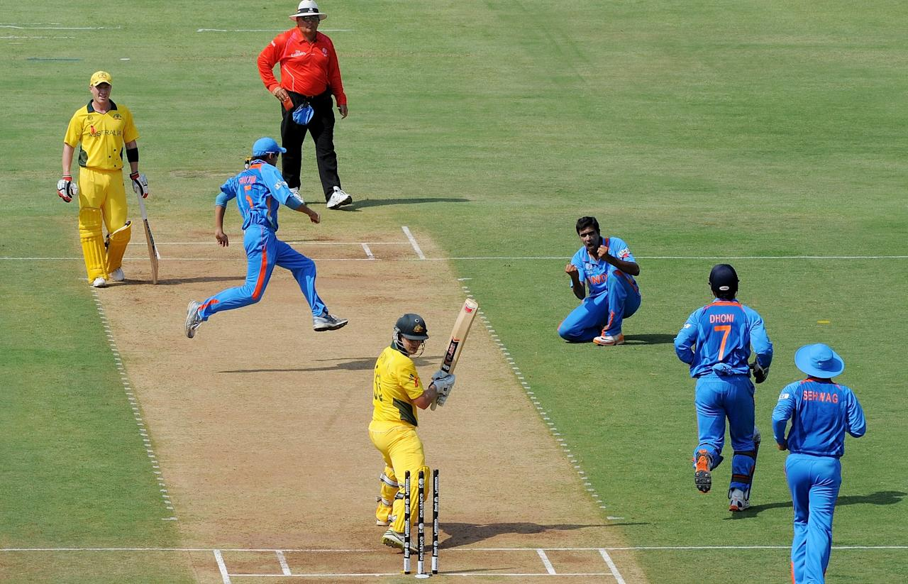 Indian off-spinner Ravichandran Ashwin (3rd R) reacts after taking the wicket of Australian cricketer Shane Watson (C) during the Cricket World Cup quarter-final match between India and Australia at the Sardar Patel Stadium in Ahmedabad on March 24, 2011.   AFP PHOTO/MANAN VATSYAYANA