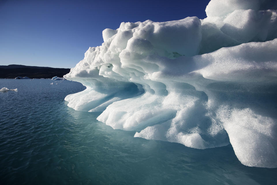 An icebergs floats in the Nuup Kangerlua Fjord near Nuuk in southwestern Greenland, Tuesday Aug. 1, 2017. Greenland's glaciers have been melting and retreating at an accelerated pace in recent years due to warmer temperatures. If all of that ice melts, sea levels will rise by several meters, though there will be regional differences. (AP Photo/David Goldman)