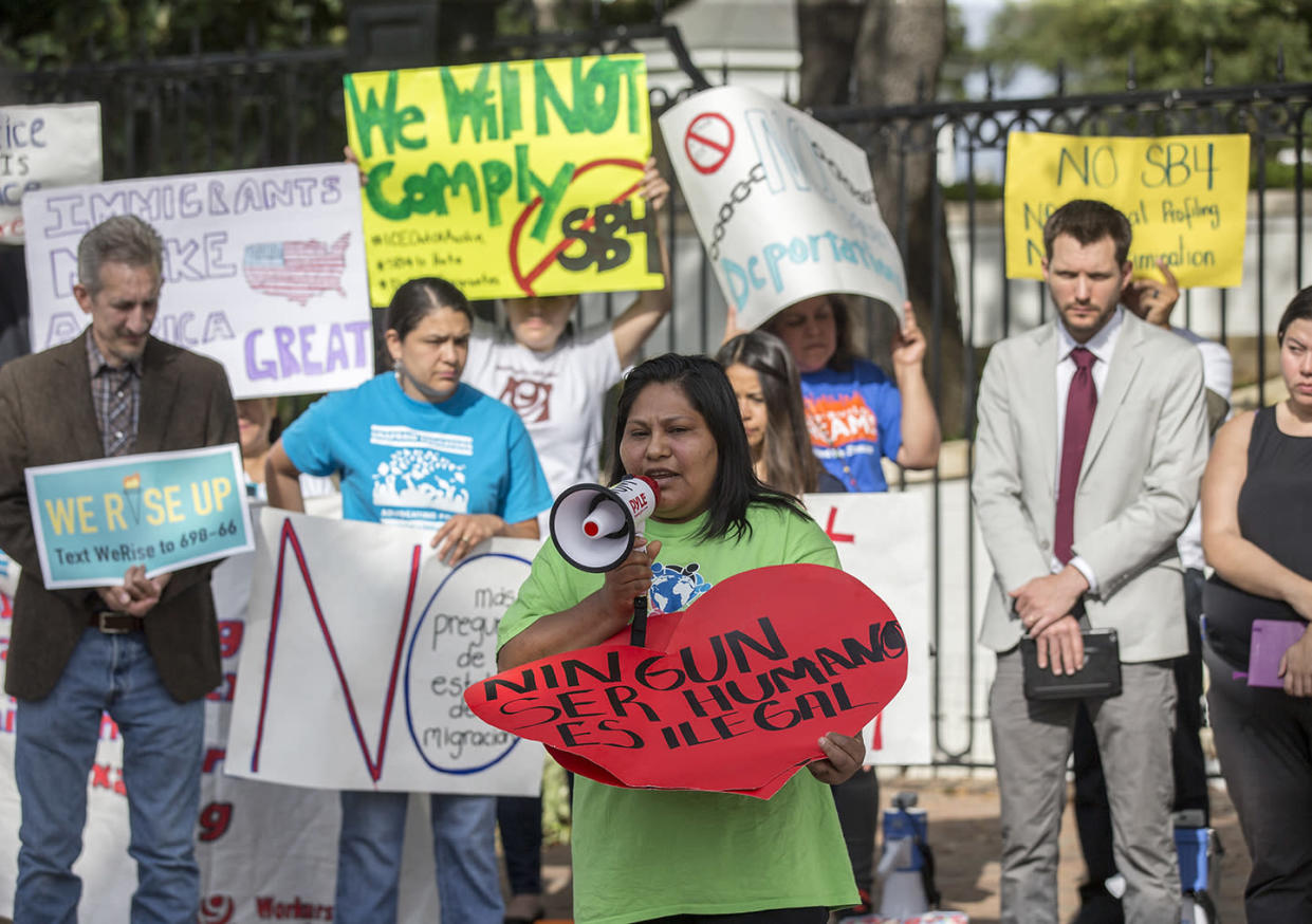 Protesters gather to protest SB4, a Texas law that will allow police officers to ask about the immigration status of anyone they detain. (Photo: Ricardo B. Brazziell/Austin American-Statesman via AP)