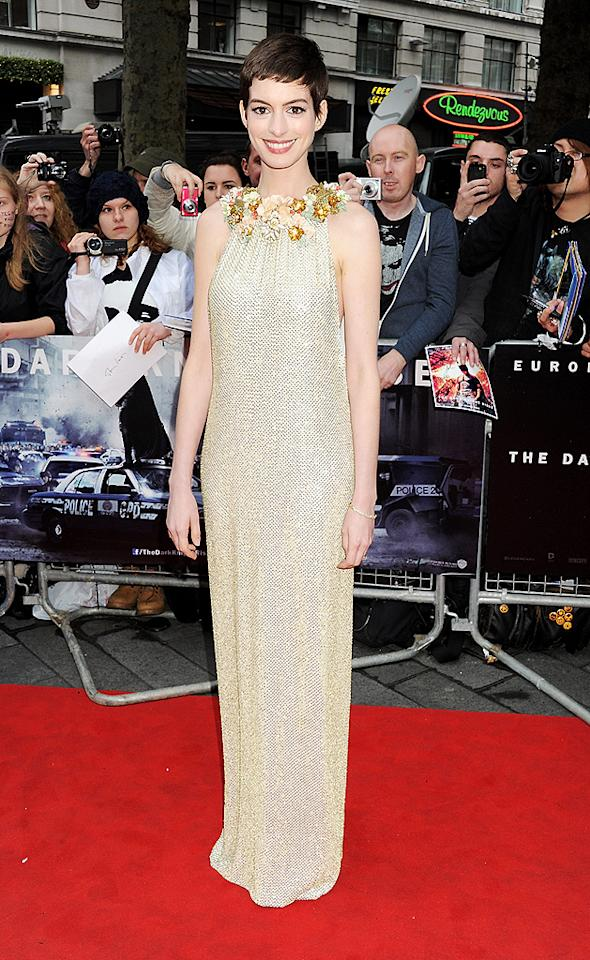 """Finally, a dress that doesn't make Anne Hathaway's butchered 'do look like even more of a disaster. Wearing a gorgeous Gucci gown -- complete with floral neckline -- the statuesque actress stole the spotlight at the European premiere of <a target=""""_blank"""" href=""""http://movies.yahoo.com/movie/the-dark-knight-rises/"""">""""The Dark Knight Rises.""""</a> As Catwoman would say, """"Meow!"""" (7/18/2012)"""