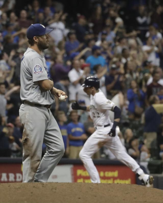 Los Angeles Dodgers starting pitcher Clayton Kershaw walks back to the mound after giving up a home run to Milwaukee Brewers' Christian Yelich during the sixth inning of a baseball game Saturday, July 21, 2018, in Milwaukee. (AP Photo/Morry Gash)