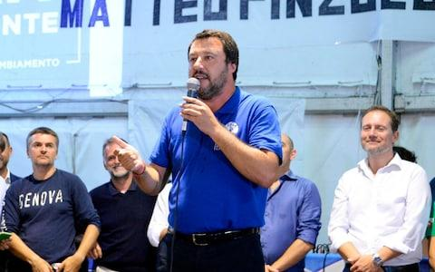 Italian Deputy Premier and Interior Minister, Matteo Salvini, speaks at a Lega party's meeting in Pinzolo, Italy, Saturday - Credit:  Daniele Panato/ ANSA