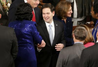 U.S. Senator Marco Rubio (R-FL) is greeted by colleagues as he arrives to listen to U.S. President Barack Obama deliver his State of the Union address to a joint session of the U.S. Congress on Capitol Hill in Washington, January 20, 2015. (REUTERS/Jonathan Ernst)