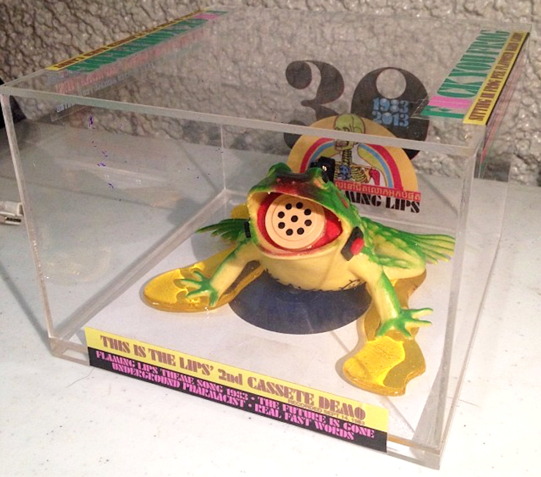 """<p>The prize for the most unusually packaged cassette release ever goes to the Flaming Lips, who issued a tape of their second demo (recorded 30 years earlier, in 1983) inside a toy frog, the open mouth of which contained an audio memo recorder with pitch-change capability built in. The Plexiglas packaging of the item suggested you could use the frog recorder to """"tell people the stuff you are too chickens — to say to their face!"""" Wayne Coyne and company unofficially dubbed it the """"F*** You Frog."""" It was released in a very limited edition of… 20 copies. If this is a froggy you'd like to go a-courtin', there's a copy currently up on eBay with a buy-it-now price of $1,333. (Photo: newfumes/Instagram) </p>"""