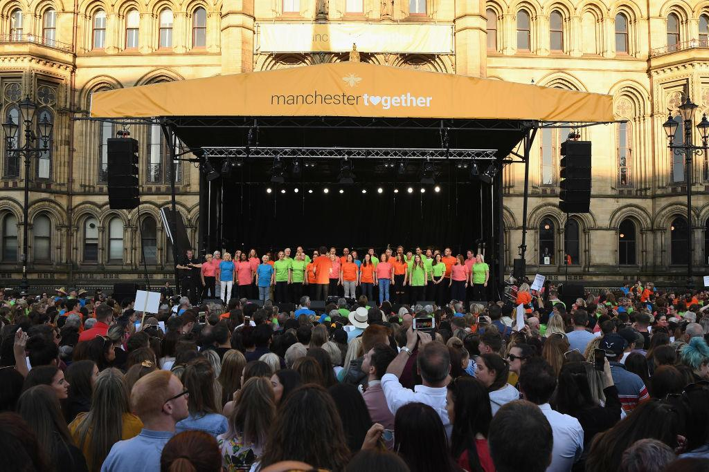 <p>A choir performs to pay tribute to the Manchester Arena Bombing victims at Albert Square on May 22, 2018 in Manchester, England. Twenty-two people were killed and hundreds injured when Salman Abedi detonated a bomb at the end of an Ariana Grande concert at Manchester Arena on 22 May 2017. </p>