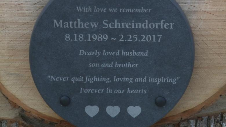 Family, friends say goodbye to Matthew Schreindorfer during candlelight ceremony