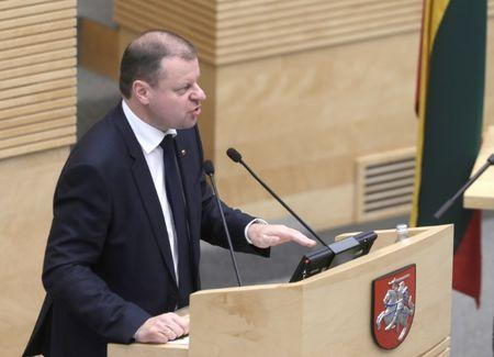Lithuania's designated Prime Minister Skvernelis addresses before swearing in office in the Parliament in Vilnius