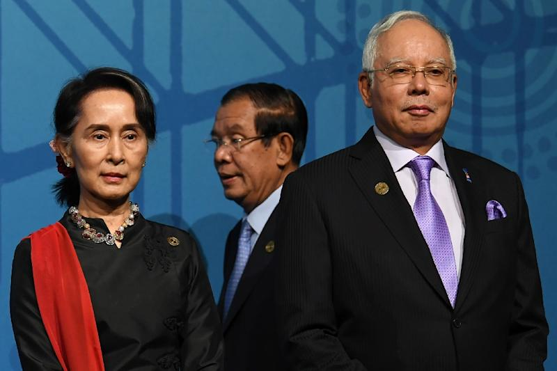 Malaysia's Prime Minister Najib Razak (R with Aung San Suu Kyi) raised fears that the displaced Rohingya who fled Myanmar could fall prey to extremist groups