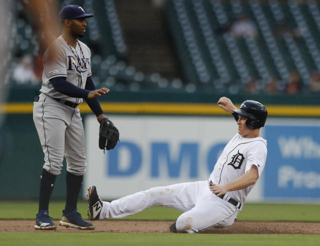 Detroit Tigers' Brandon Dixon reaches third from first on a single by Harold Castro during the fourth inning of the team's baseball game against the Tampa Bay Rays on Wednesday, June 5, 2019, in Detroit. (AP Photo/Carlos Osorio)