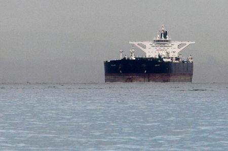 """FILE PHOTO: Malta-flagged Iranian crude oil supertanker """"Delvar"""" is seen anchored off Singapore March 1, 2012. . REUTERS/Tim Chong/File Photo"""