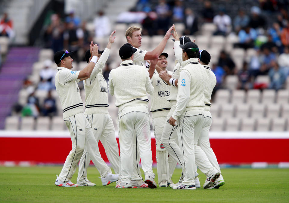 New Zealand's Kyle Jamieson celebrates with teammates the dismissal of India's Rohit Sharma during the second day of the World Test Championship final cricket match between New Zealand and India, at the Rose Bowl in Southampton, England, Saturday, June 19, 2021. (AP Photo/Ian Walton)