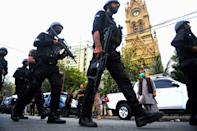Police commandos patrol near the Pakistan Stock Exchange building following an attack by gunmen in Karachi on June 29, 2020. - At least six people were killed when gunmen attacked the Pakistan Stock Exchange in Karachi on June 9, with a policeman among the dead after the assailants opened fire and hurled a grenade at the trading floor, authorities said. (Photo by Asif HASSAN / AFP) (Photo by ASIF HASSAN/AFP via Getty Images)