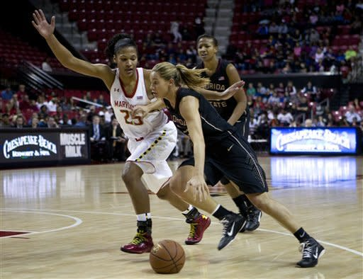 Florida State's Alexa Deluzio (3) moves the ball against Maryland's Alyssa Thomas (25) during the first half of an NCAA women's college basketball game at the Comcast Center in College Park, Md., on Sunday, Jan. 6, 2013. (AP Photo/Jose Luis Magana)