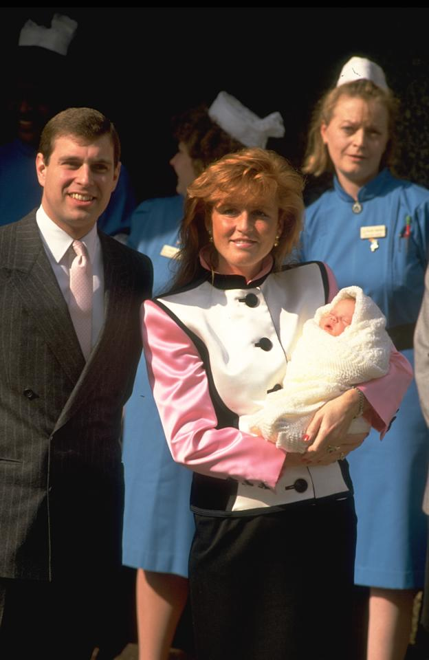 On March 23, 1990, the Duchess of York held newborn daughter Princess Eugenie during a photo call outside Portland Hospital in London. [Photo: Getty]