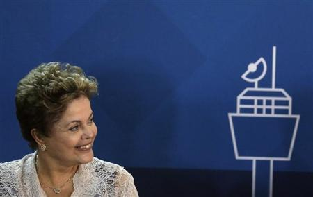 Brazil's President Dilma Rousseff attends the signing ceremony of the Rio de Janeiro's international airport concession in Rio de Janeiro