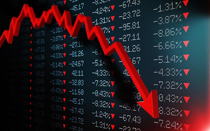Stock exchange market is falling. Red arrow graph is showing a fall on a black trading board. Selective focus. Horizontal composition with copy space.