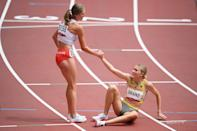 <p>Martyna Galant of Team Poland helps up Caterina Granz of Team Germany after competing in round one of the Women's 1500m heats on day ten of the Tokyo 2020 Olympic Games at Olympic Stadium on August 02, 2021 in Tokyo, Japan. (Photo by Matthias Hangst/Getty Images)</p>