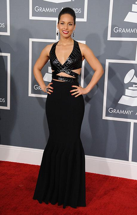 Alicia Keys bares enough skin on the red carpet in an Azzedine Alaia gown. The accent: red lips and polish. This is how you do cutouts with class.