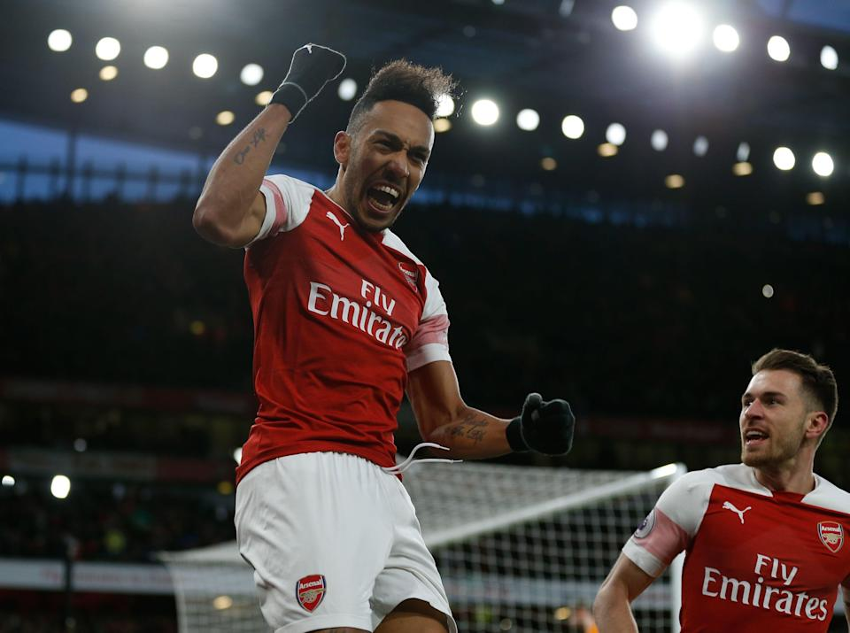 Arsenal's Gabonese striker Pierre-Emerick Aubameyang (C) celebrates scoring their second goal from the penalty spot during the English Premier League football match between Arsenal and Manchester United at the Emirates Stadium in London on March 10, 2019. (Photo by Ian KINGTON / IKIMAGES / AFP) / RESTRICTED TO EDITORIAL USE. No use with unauthorized audio, video, data, fixture lists, club/league logos or 'live' services. Online in-match use limited to 45 images, no video emulation. No use in betting, games or single club/league/player publications.        (Photo credit should read IAN KINGTON/AFP/Getty Images)