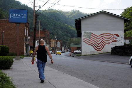 A man walks through downtown War, West Virginia, U.S., May 19, 2018. REUTERS/Brian Snyder