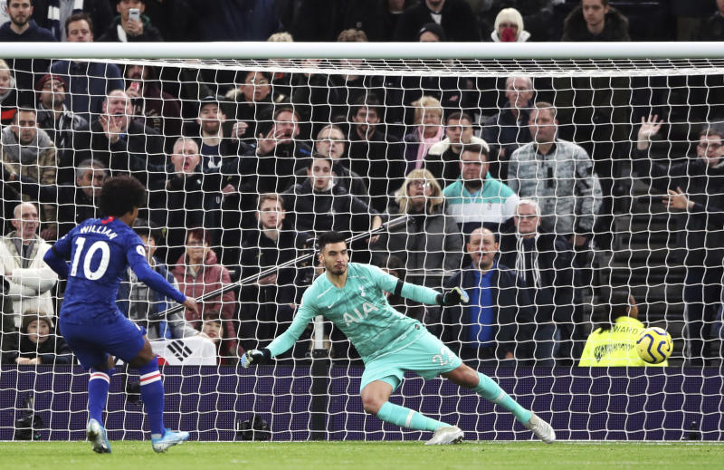 Chelsea's Willian scores his side's second goal of the game from the penalty spot during the English Premier League soccer match against Tottenham, at the Tottenham Hotspur Stadium, London, Sunday, Dec. 22, 2019. (Nick Potts/PA via AP)