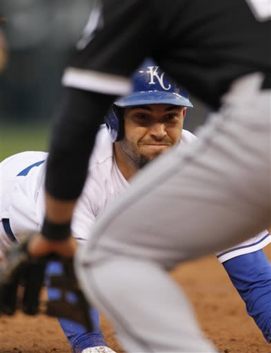 Kansas City Royals' Eric Hosmer slides into third base after hitting a triple in the third inning of a baseball game against the Chicago White Sox at Kauffman Stadium in Kansas City, Mo., Saturday, May 4, 2013. (AP Photo/Colin E. Braley)