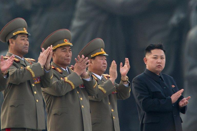 North Korean leader Kim Jong-Un (R) claps during an unveiling ceremony for statues in Pyongyang on April 13, 2012