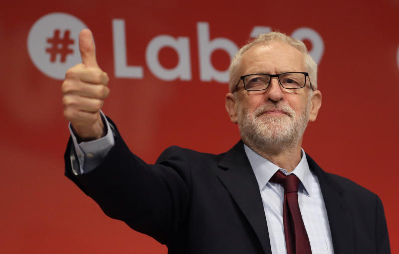 Jeremy Corbyn, leader of Britain's opposition Labour Party gives a thumbs up as a reaction to the news from Britain's Supreme Court, on stage during the Labour Party Conference at the Brighton Centre in Brighton, England, Tuesday, Sept. 24, 2019. The Supreme Court has ruled that Britain's Prime Minister Boris Johnson's suspension of Parliament was unlawful. (AP Photo/Kirsty Wigglesworth)