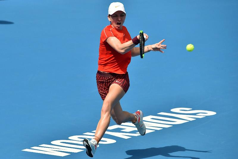 Ash Barty stuns world No.1 Simona Halep