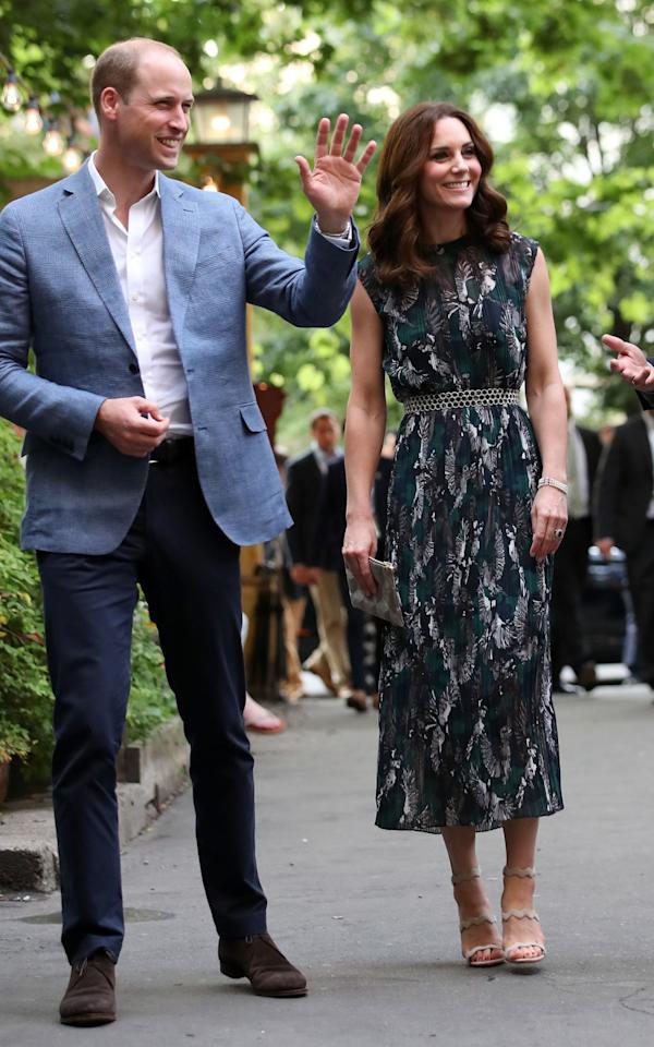 <p><b>Kate turned to German-born London Fashion Week designer Markus Lupfer for a sleeveless, midi dress worn to an evening event at the Clarchens Ballhaus in Germany on day four of the royal tour. <br /><em>[Photo: PA]</em> </b></p>