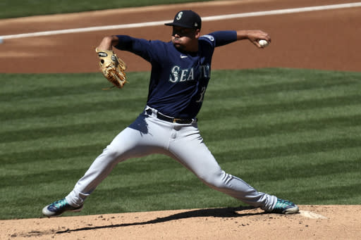 Seattle Mariners' Justus Sheffield pitches against the Oakland Athletics during the first inning of the first baseball game of a doubleheader in Oakland, Calif., Saturday, Sept. 26, 2020. (AP Photo/Jed Jacobsohn)