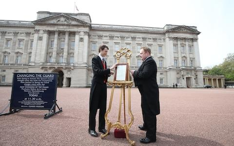 An easel is placed in the Forecourt of Buckingham Palace in London to announce the birth of a baby girl. - Credit: Steve Parsons /PA