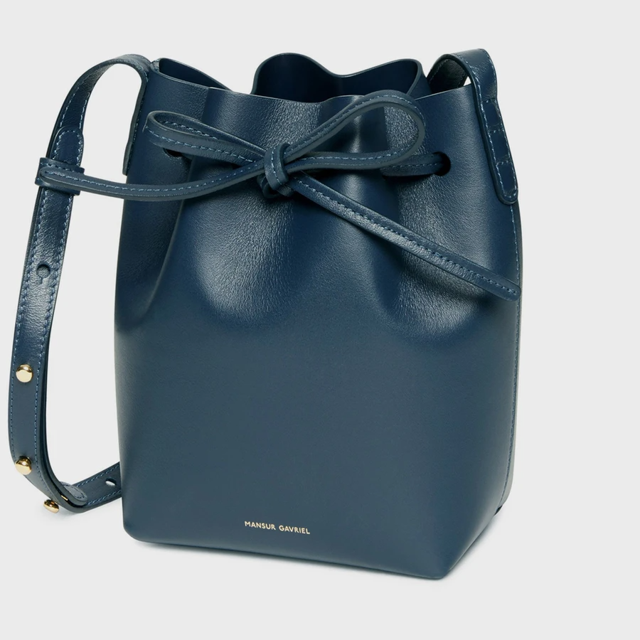 "<h2>Mansur Gavriel<br></h2><br><strong>Dates:</strong> Now - Nov. 27<br><strong>Sale:</strong> <a href=""https://www.mansurgavriel.com/collections/sale-view-all"" rel=""nofollow noopener"" target=""_blank"" data-ylk=""slk:50% off select handbags & shoes"" class=""link rapid-noclick-resp"">50% off select handbags & shoes</a><br><strong>Promo Code: </strong>None<br><br><em>Shop <strong><a href=""https://www.mansurgavriel.com/collections/sale-view-all"" rel=""nofollow noopener"" target=""_blank"" data-ylk=""slk:Mansur Gavriel"" class=""link rapid-noclick-resp"">Mansur Gavriel</a></strong></em><br><br><strong>Mansur Gavriel</strong> Mini Mini Bucket Bag, $, available at <a href=""https://go.skimresources.com/?id=30283X879131&url=https%3A%2F%2Fwww.mansurgavriel.com%2Fproducts%2Fcalf-mini-mini-blu"" rel=""nofollow noopener"" target=""_blank"" data-ylk=""slk:Mansur Gavriel"" class=""link rapid-noclick-resp"">Mansur Gavriel</a>"