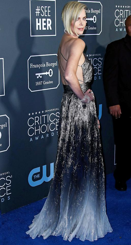 in a one-shoulder metallic silver ombré gown by Givenchy with Messika jewels at the Critics' Choice Awards.