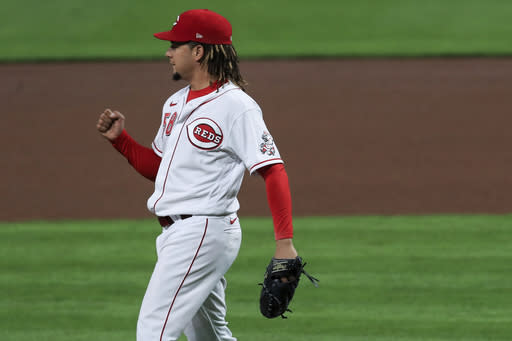 Cincinnati Reds' Luis Castillo reacts to striking out Pittsburgh Pirates' Kevin Newman during the seventh inning of a baseball game in Cincinnati, Wednesday, Sept. 16, 2020. (AP Photo/Aaron Doster)