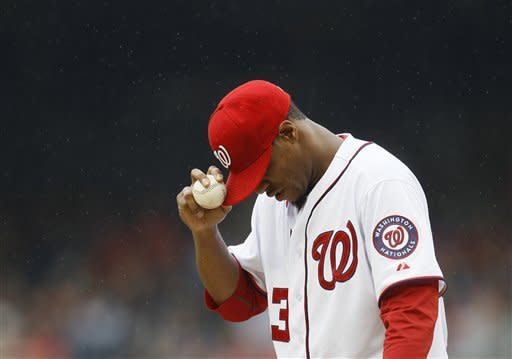 Washington Nationals starting pitcher Edwin Jackson pauses during the first inning in the first baseball game of a doubleheader against the Atlanta Braves, Saturday, July 21, 2012, in Washington. (AP Photo/Carolyn Kaster)
