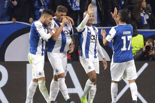 Brazilian Tiquinho Soares scored twice as Porto warmed up for Wednesday's Champions League tie against Liverpool with a 4-0 thumping of Chaves on Sunday to retake top spot in Portugal from Benfica.