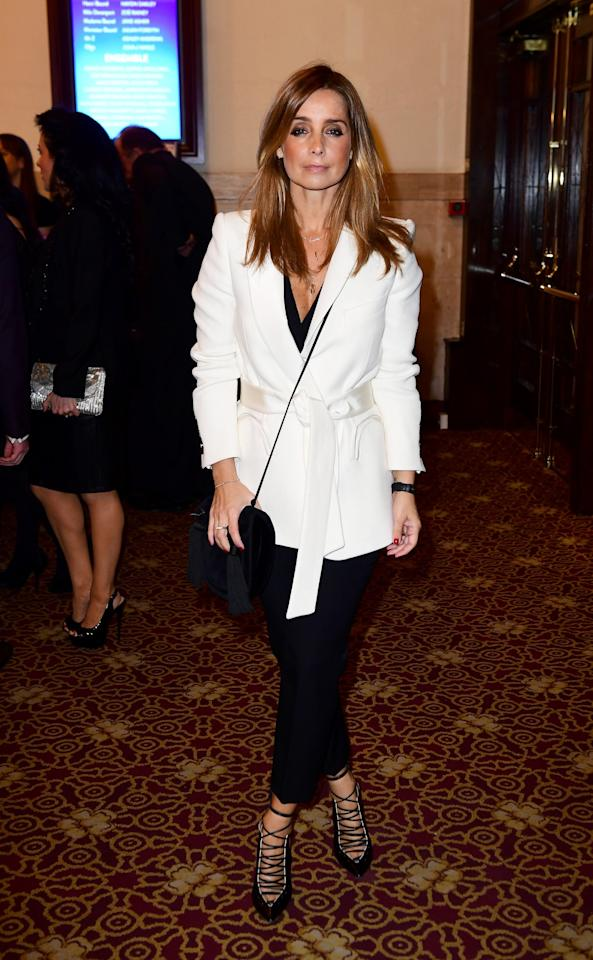 <p>Redknapp's waist-tie jacket with all-black accessories looked rather smart at the An American In Paris Gala [Photo: PA] </p>