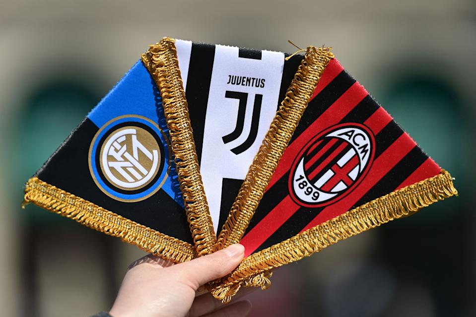 This picture taken in Milan on April 20, 2021 shows three logos of Italian teams, Inter Milan, Juventus and AC Milan that would participate in the Super League. - FIFA president Gianni Infantino said on April 20 that there is