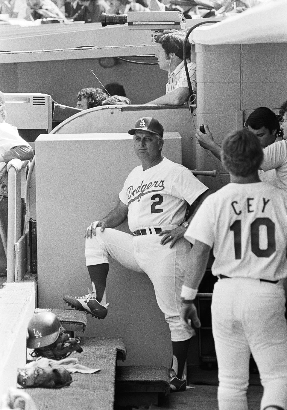 New manager Tommy Lasorda looks over his domain from the dugout as his Los Angeles Dodgers downed the San Francisco Giants in Los Angeles on Thursday, April 8, 1977. It was 5-1. It was Lasorda's first game as a major league skipper. (AP Photo)