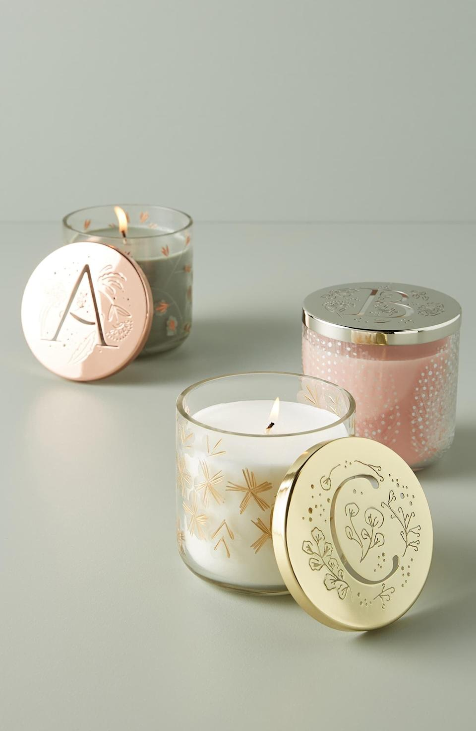 "<p>Make them feel special with this <a href=""https://www.popsugar.com/buy/Anthropologie-Lumi-Monogram-Scented-Candle-532946?p_name=Anthropologie%20Lumi%20Monogram%20Scented%20Candle&retailer=shop.nordstrom.com&pid=532946&price=28&evar1=fab%3Aus&evar9=36291197&evar98=https%3A%2F%2Fwww.popsugar.com%2Ffashion%2Fphoto-gallery%2F36291197%2Fimage%2F47027893%2FAnthropologie-Lumi-Monogram-Scented-Candle&list1=shopping%2Choliday%2Cwinter%2Cgift%20guide%2Cwinter%20fashion%2Choliday%20fashion%2Cfashion%20gifts&prop13=api&pdata=1"" rel=""nofollow noopener"" class=""link rapid-noclick-resp"" target=""_blank"" data-ylk=""slk:Anthropologie Lumi Monogram Scented Candle"">Anthropologie Lumi Monogram Scented Candle</a> ($28).</p>"
