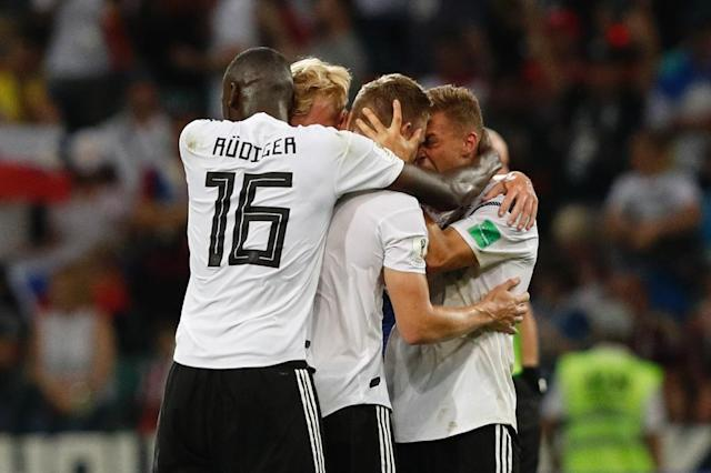 Relieved German players celebrate after Toni Kroos's winner against Sweden (AFP Photo/Adrian DENNIS)