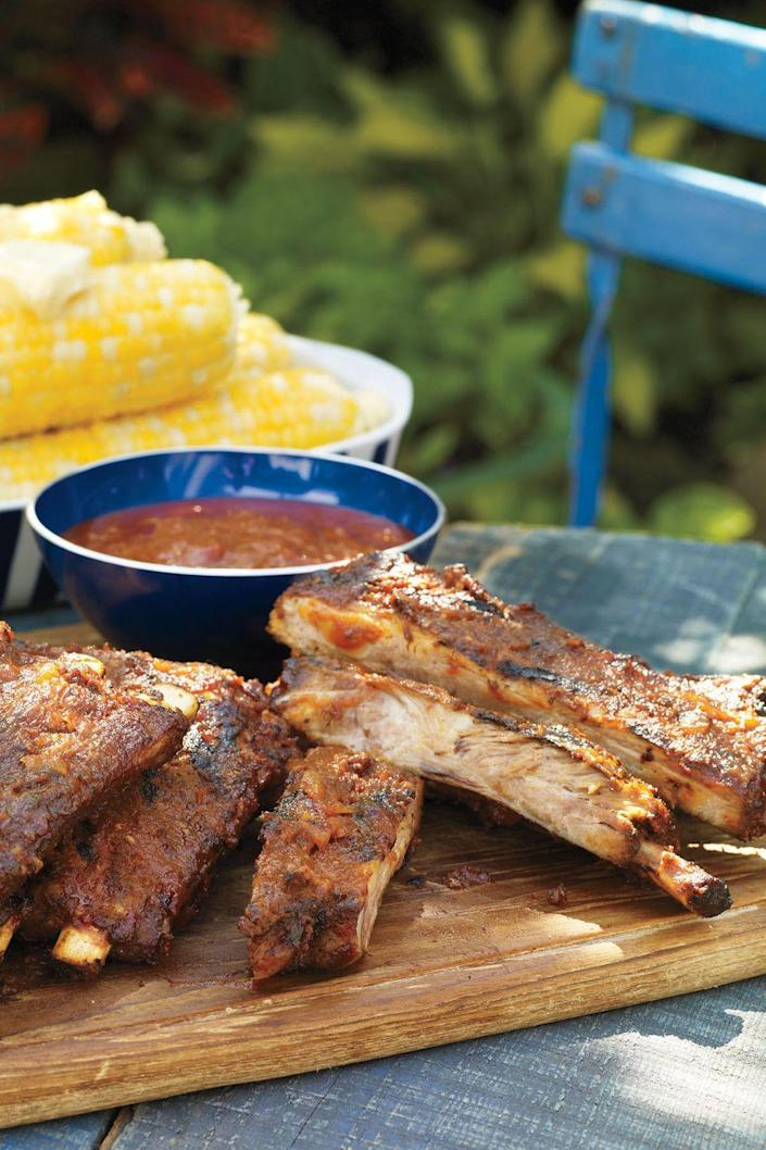 """<p>You'll need to set out extra napkins for these tangy spare ribs, which come slathered in barbecue sauce, apricot jam, soy sauce, and yellow mustard. </p><p><u><em><strong><a href=""""https://www.womansday.com/food-recipes/food-drinks/recipes/a11330/bbq-ribs-mopping-sauce-recipe-122668/"""" rel=""""nofollow noopener"""" target=""""_blank"""" data-ylk=""""slk:Get the recipe for Barbecue Ribs with Mopping Sauce"""" class=""""link rapid-noclick-resp"""">Get the recipe for Barbecue Ribs with Mopping Sauce</a>.</strong></em></u><br></p>"""