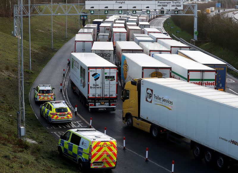 FILE PHOTO: Freight vehicles line up prior to boarding a train to France via the Channel Tunnel, amid the coronavirus disease (COVID-19) outbreak, in Folkestone