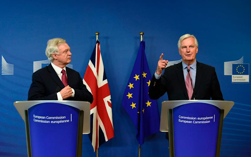 David Davis began negotiations with Michel Barnier today, but economists fear the Government could fall over before they make substantive progress - AFP